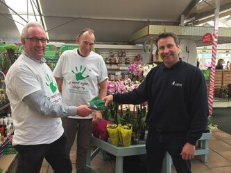 Gavin Cooper and Richard Cumming from Orchard Park complete their sponsored walk to Lakeside Garden Centre